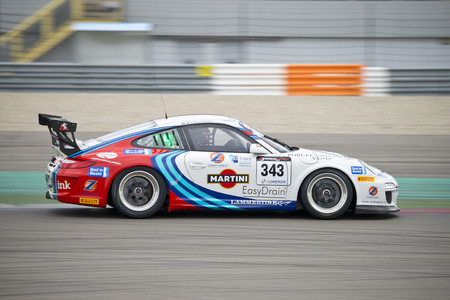 gt3: ASSEN, NETHERLANDS - OCTOBER 19, 2014: A porsche 911 at full speed during the supercar challenge and Porsche cup during Acceleration 2014 at the TT Circuit in Assen Editorial