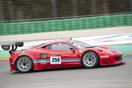 assen: ASSEN, NETHERLANDS - OCTOBER 19, 2014: Ferrari at full speed during the supercar challenge and GT cup during Acceleration 2014 at the TT Circuit in Assen Editorial