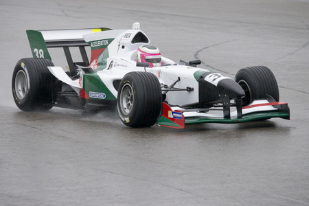 ASSEN, NETHERLANDS - OCTOBER 19, 2014: Team Mexicos car racing on a wet TT circuit during the final race of the acceleration FA1 Grand Prix European Circuit.