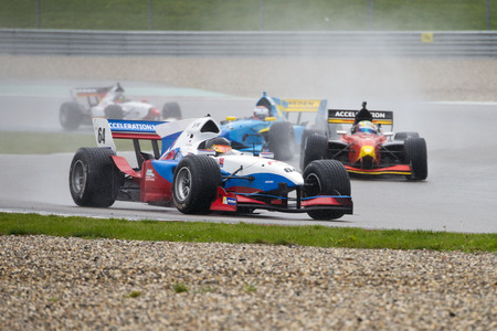 acceleration: ASSEN, NETHERLANDS - OCTOBER 19, 2014: Team Slovenia in the lead of the Formula A1 GP division during a wet race on the TT circuit, Assen Editorial