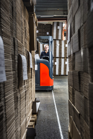 maneuvering: reach truck driver in a warehouse with lots of copy space