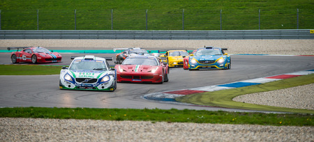 eachother: ASSEN, NETHERLANDS - OCTOBER 19, 2014: Competitors in the supercar challenge following eachother through a chicane on TT Circuit Assen
