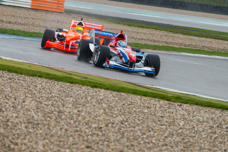 assen: ASSEN, NETHERLANDS - OCTOBER 19, 2014: Team Netherlands in pursuit of Team Great Britain during the final race of the Formula A1 GP Acceleration tour.