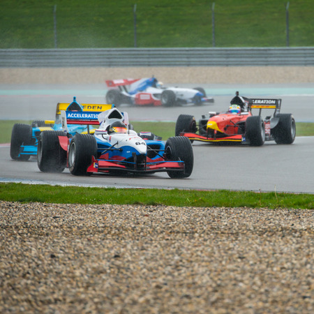 assen: ASSEN, NETHERLANDS - OCTOBER 19, 2014: Formula FA1 cars druing the warm up lap of the final wet race of the Acceleration 2014 tour Editorial