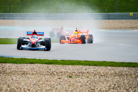 gp: ASSEN, NETHERLANDS - OCTOBER 19, 2014: Team Great Britain in the lead, followed by Team Holland during the final race of the Formula A1 GP Acceleration tour. Editorial