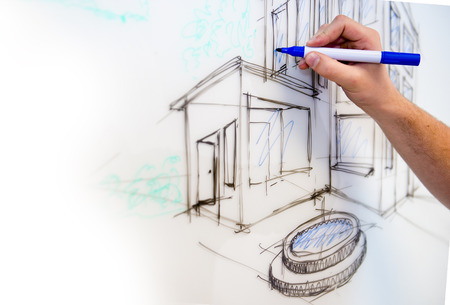 impressions: Mans hand creating a free drawing of a mansion in perspective on a whiteboard as rough sketch