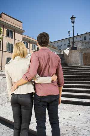 spanish steps: Young lovers looking at the spanish steps in Rome, sightseeing and visiting the highlights as tourists