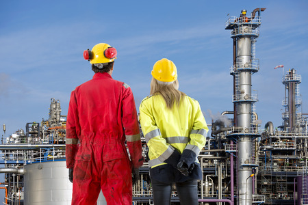 formulation: Two petrochemical engineers looking at a new cracking facility for hydrocarbon products used in polyurethane compounds