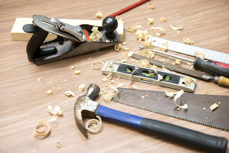 wood shavings: Jack plane with carpentry tools and wood shavings on floor
