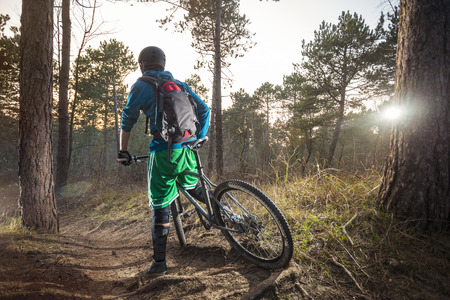 off road biking: Young man is ready to go on his ATB through the forest trail Stock Photo