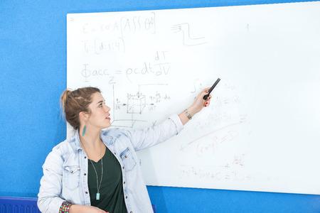 explaining: Female designer explaining sketch on paper in creative office