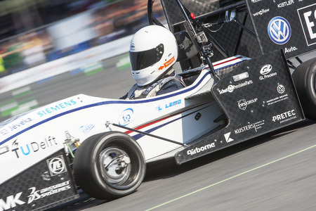 technical university: HOCKENHEIM, GERMANY - AUGUST 2, 2015: The four wheel powered electronic car, designed and built by Formula Student Team Delft from the Technical University Delft is the officious world champion of the Formula Student Design Competition