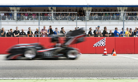 world championships: HOCKENHEIM, GERMANY - AUGUST 1, 2015: Formula Student team from the University of Applied Sciences in Coburg crosses the finish line of the accelleration trial during the  unofficious world championships in the Combustion class