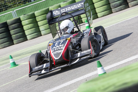world championships: HOCKENHEIM, GERMANY - AUGUST 1, 2015: An electronic concept car during the world championships of the formula student design competition during the dynamic endurance on the hockenheimring circuit.