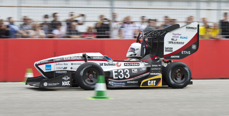 2 0: HOCKENHEIM, GERMANY - AUGUST 1, 2015: Team AMZ from ETH Zurich during the accelleration event at Formula Student Germany. The current world record holders car accellerates from 0 to 100 kmh in 2,1s.