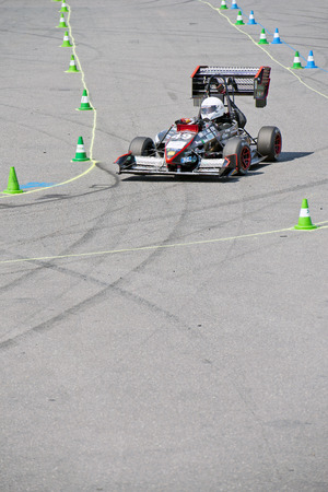 world championships: HOCKENHEIM, GERMANY - AUGUST 1, 2015: Unique designs of  race cars during the world championships of the formula student design competition during the dynamic endurance on the hockenheimring circuit.