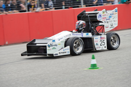 HOCKENHEIM, GERMANY - AUGUST 1, 2015: The automotive design competition for university teams display some unique, innovative and conceptual aerodynamic solutions for lightweight race cars. Imagens - 43511875