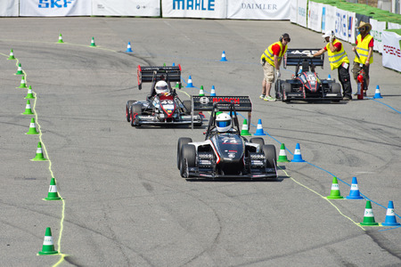 world championships: HOCKENHEIM, GERMANY - AUGUST 1, 2015: Close råcing during the final Endurance Race of the officious world championships Formula Student on the Hockenheim Ring Editoriali