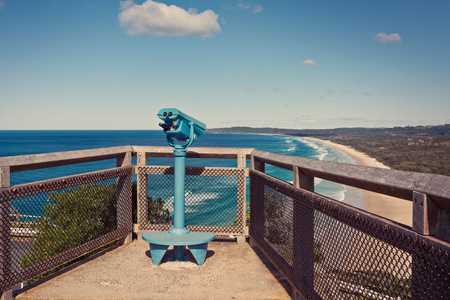 byron: Binoculars overlooking the Gold Coast beaches and the ocean, on a cliff near byron bay lighthouse.