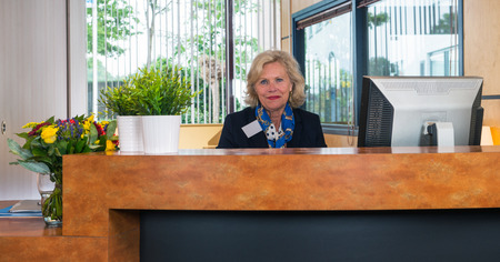 Re-integrating into the working process as a receptionist of a large firm. Stock Photo - 47413101