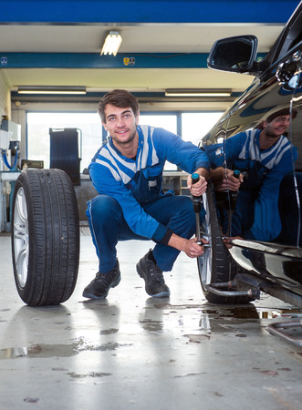 all weather: Mechanic, mounting winter tires on a vehicle for vehicle and road safety