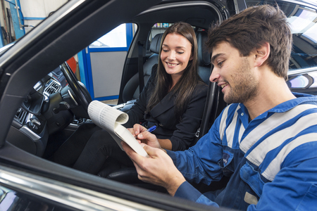 proble: Car mechanic shows the repairs to the customer on the work order