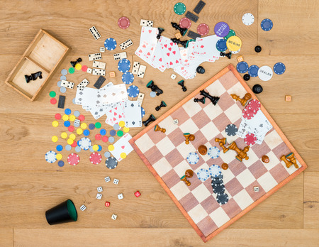 Directly above shot of various leisure games spread on wooden table Archivio Fotografico