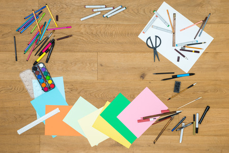 crayon  scissors: Directly above shot of painting tools on wooden table