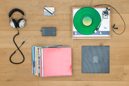 directly: Directly above shot of turntable with records and headphones on table Stock Photo