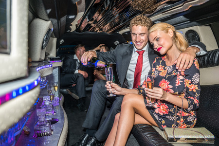 celebrities: Man Serving Champagne For Girlfriend In Limousine