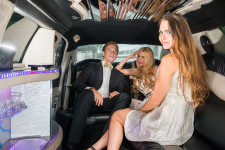 glamorous: Glamorous Woman Sitting With Friends In Limousine
