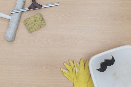 Window cleaning concept with supplies on wooden background. View from above