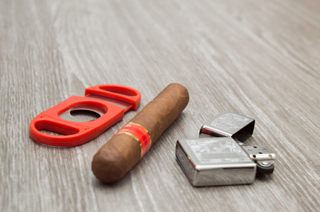 attributes to smoke a cigar, on a wooden background, front view, with copy space