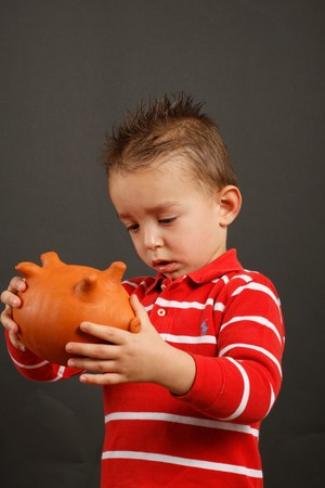 A child watch his biggy bank Stock Photo - 6967379
