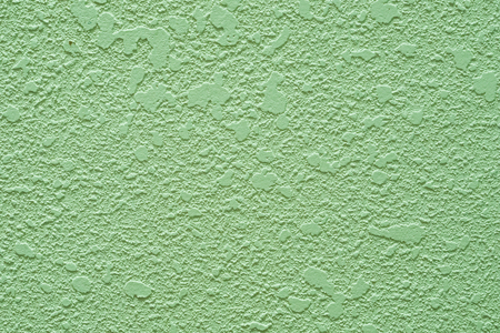 Green concrete wall, abtract background with specific texture.