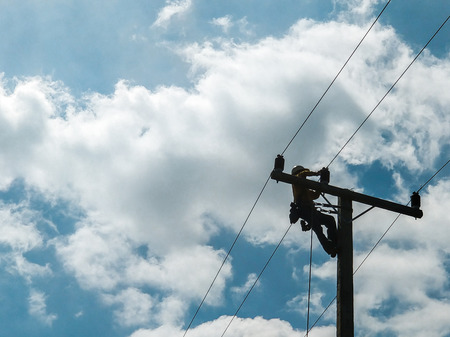 The lineman resolving power failure by replacing broken electrical insulator with lightning. That causes a blackout.