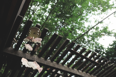 wind chime: Ceramic Wind chimes in a garden Stock Photo