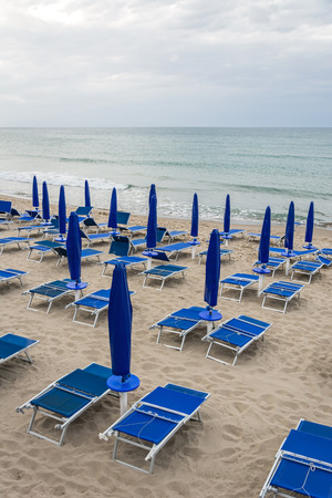 Empty beach loungers on deserted beach in low season