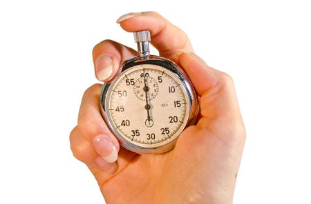 Mano femminile che tiene un cronometro