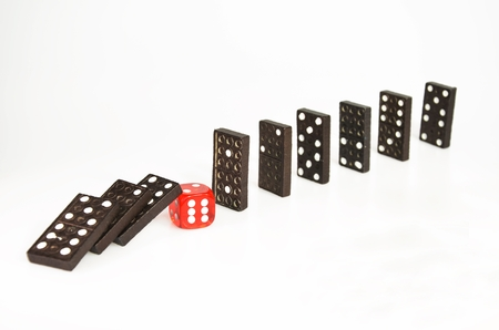 Domino pieces falling or stopped by red dice