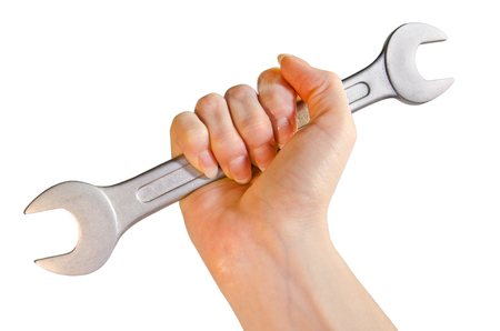 Female hand holding wrench in front of white background Reklamní fotografie