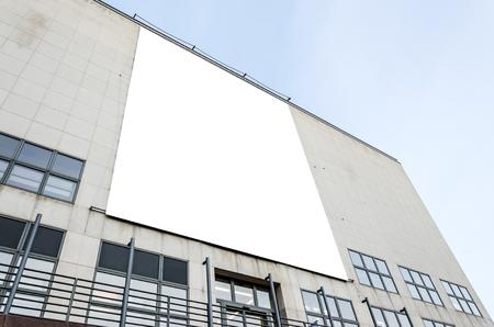 Large blank billboard on a gray modern building wall Stock fotó