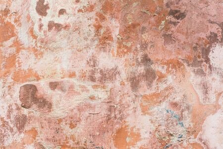Background: weathered red paint on concrete wall Stock Photo
