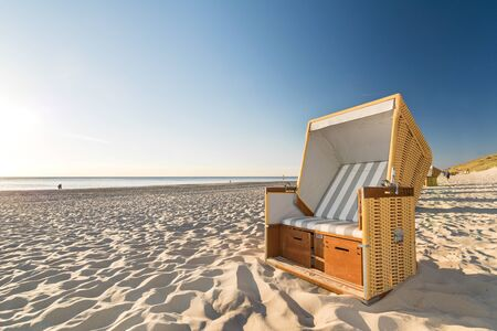 Beach chair at the shore in the evening sun in Northern Germany on the island of Sylt Stock fotó