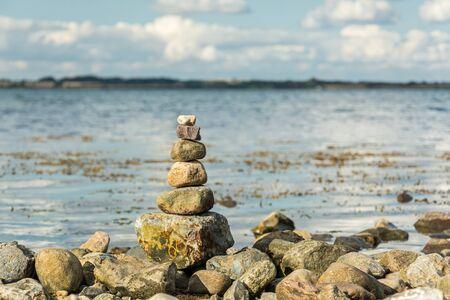 Scenic spiritual stone tower at the seashore