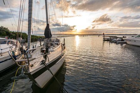 Marina with sailing boats during dramatic sunset Stok Fotoğraf