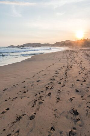 Tropical beach at sunset at the Pacific Ocean