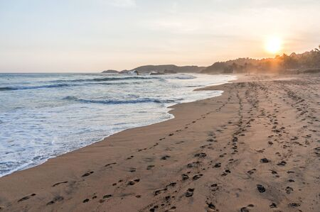 Beautiful peaceful beach at sunset in Mazunte, Mexico Фото со стока