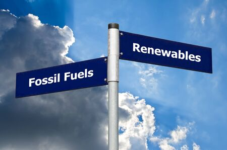 Street sign in the front of a cloudy sky representing a choice between ? ?? fossil fuels? ?? and renewables