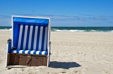 Lonely beach chair at the beach in Northern Germany